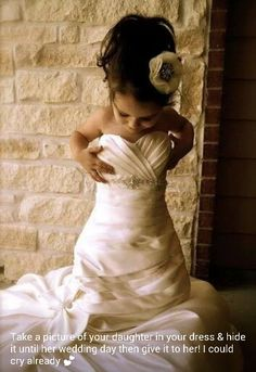 Love this.♥ daughter takin a pic in mother's wedding dress