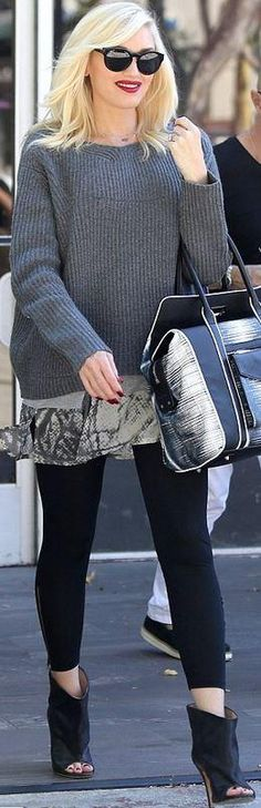 Who made Gwen Stefani's black open toe ankle boots, sunglasses, white print handbag, and black sunglasses? Sunglasses – Stella McCartney  Purse – L.A.M.B.  Shoes – Maison Martin Margiela