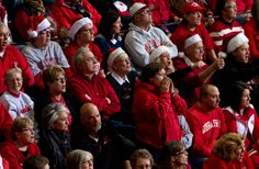 More than a few santas were in the crowd as Nebraska played Oregon in the second round of the NCAA volleyball tournament on Dec. 7, 2013. By: MARK DAVIS/THE WORLD-HERALD