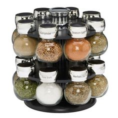 Filled with premium spices, Kamenstein's Ellington Spice Rack is an attractive way to keep your favorite spices close at hand while saving counter space. The glass jars have chrome-plated caps which feature both sift and pour options. Spice Rack Glass, Glass Spice Jars, Glass Bottles, Spice Racks, Glass Food Storage, Food Storage Containers, Kitchen Organization, Kitchen Storage, Bathroom Storage