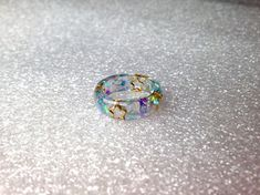 Cute Blue Ring, Pastel Goth, Kawaii Resin Ring, Soft Grunge, Decora, Lolita Ring, Fairy Kei Ring, Blue Resin Ring. Blue Ring, Kawaii Jewelry These rings are made of UV resin. In them contain blue sequins with cute golden stars in them. These rings are ideal for any magical girl!