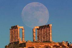 The supermoon rises over the temple of Poseidon, the ancient Greek god of the seas, in Cape Sounion,... - REUTERS/Yannis Behrakis