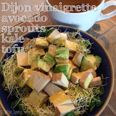 Kale salad with avocado, sprouts, tofu and Dijon Vinaigrette dressing