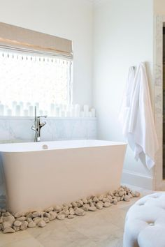 Duane and Devi went for a spa-like feeling in their shared bathroom with a stand-alone bathtub surrounded smooth, white stones, an oversized rainfall shower and natural wood chandelier. They splurged on a Japanese toilet with a heated seat.