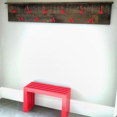 Red infinity bench and reclaimed oak coat rack