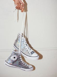 Holiday Party High Top Chucks   Super sparkly sequin embellished high-top converse. Dressed up or down these sneaks will definitely make a statement.