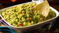 South of the border guacamole dip. sounds delicious :)  •1 lb. Mission® Tortilla Strips  •2 large ripe Avocados  •1 medium Tomato, chopped  •1 Green Onion, chopped  •2 Green Chile Peppers, seeded and chopped   •1/8 tsp. Black Pepper  •3 Tbsp. Lemon Juice  1. Chop avocados coarsely and mash until smooth. Serve with Mission® Tortilla Strips.  2.Add tomato, onion and chiles and mix gently. Add pepper and lemon juice. Stir. 3. Cover tightly with plastic wrap until ready to serve.