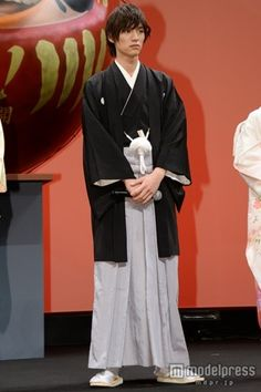 Sota Fukushi in montsuki-hakama.  Montsuki-hakama: formal Japanese attire for a man, consisting of a kimono dyed with the family crest and a long, loose, pleated skirt