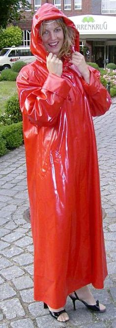 Hooded red pvc mackintosh