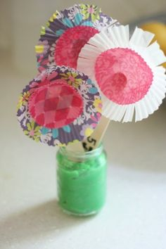 """Mother's Day Flowers: Craft Sticks,Cupcake Liners (both the regular size and the mini), scissors, a glue stick, a permanent marker, and a small container to put the """"flowers"""" in. Write on each craft stick, (1 Giant Hug, 5 Minutes of Cuddle Time, Wipe Down the Kitchen Table, Fold Laundry, etc)"""