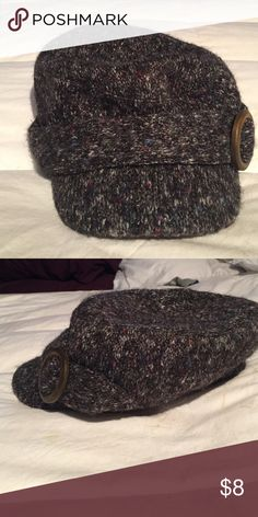 Grey Hat Small brim with a wooden accent. Looks good on and will fit a medium to large head. Has a little sparkle weaved into it. Scala Accessories Hats