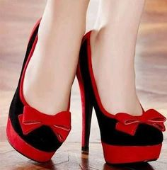 Black and red high heels with ribbon.