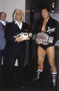 NWA champion Ric Flair and AWA champion Jumbo Tsuruta (Verne Gagne is behind them left.)