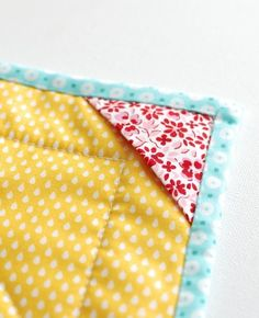 Retro Mama | pockets on mini quilt for hanging