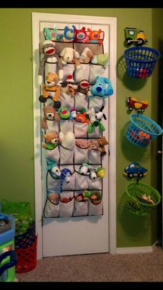 Dollar Tree baskets hung on wall for toys. Shoe holder for toys/cars - great idea too!  For the playroom