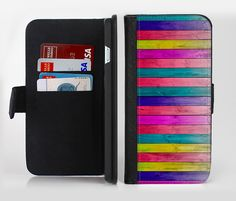 The Vibrant Neon Colored Wood Strips Ink-Fuzed Leather Folding Wallet Credit-Card Case for the Apple iPhone 6/6s, 6/6s Plus, 5/5s and 5c from DesignSkinz