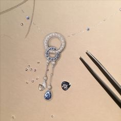 Diamonds and sapphires for an Art Deco style necklace. The asymmetry of the pendant rose cut diamond and the sapphire break the rigidity of the shapes.