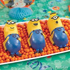 Feel like a decorating super-villain with these Minions cakes! With the help of our Minions Kevin Cakes How-To and the Minions mini cakes pan, these impressive-looking cakes can be made in no time. Once decorated, just arrange them on a long platter filled with orange Sixlets®. How deviously sweet!