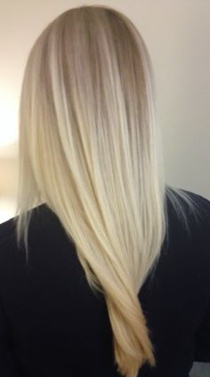 Long, light blonde hair with platinum balayage highlights