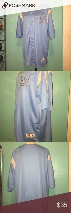 Milwaukee Brewers jersey Baby blue in color, my husband only wore it once. Great condition! True Fan Shirts
