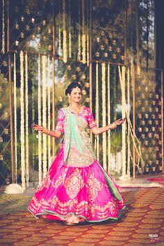 Sangeet Lehengas - Fuchsia Lehenga with Sky Blue Dupatta | WedMeGood | Pink Lehenga with Gold Foil Print, Sky Blue Net Dupatta and Gold Jewelry #wedmegood #indianwedding #indianbride #pink #lehenga #sangeet #bridal