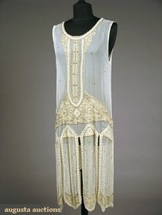 "BEADED WHITE CHIFFON FLAPPER DRESS, 1920s Pale yellow chiffon appliqued bands on white chiffon w/ deco floral patterns in white & crystal glass beads w/ scattered rhinestones, B 36"", L 41"", excellent."