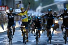 Tour de France 2013 winner Britain's Christopher Froome celebrates with teammates on the Champs-Elysee avenue in Paris, after crossing the finish line of the 133.5 km twenty-first and last stage of the 100th edition of the Tour de France cycling race on July 21.