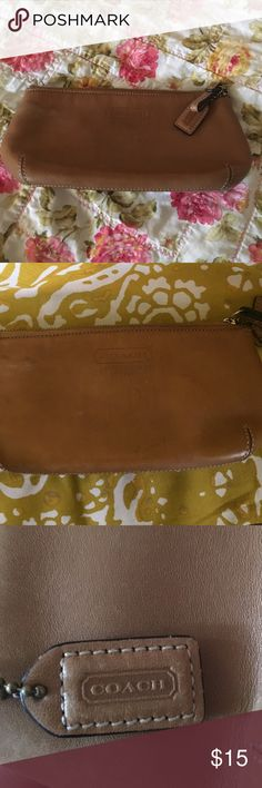 Coach makeup bag Camel colored leather Coach makeup bag. Has some discoloration, no but no holes and zipper works well. Nice bag that could still offer a lot of use. 🛍💕🛍bundle for doscount🛍💕🛍 Coach Bags Cosmetic Bags & Cases