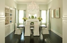 Light flooding in, the chandelier and the beautiful flower arrangements (not the chairs)
