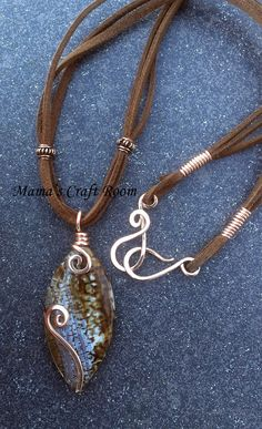 Less is More. A stunning, all natural agate pendant bead accented with bold bare copper swirls, kept nice and simple to allow Mother Nature's beauty to shine through. Finished with soft leather lace, copper beads and handmade copper clasp and coils.  www.facebook.com/MamasCraftRoom
