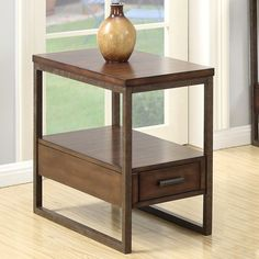 Accent your home with this functional table. Features a rustic brown finished wood table top and shelf with drawer completed with a metal base. Store remotes and other living room accessories in drawer, leaving space for electronics, drinks, or snacks. 236