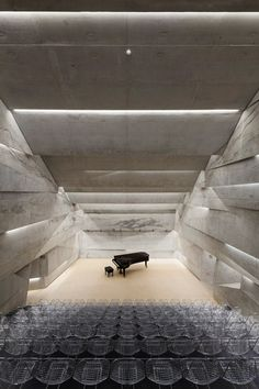 Concert hall in Blaibach by Peter Haimerl is a stone-clad concrete volume which tilts at an angle