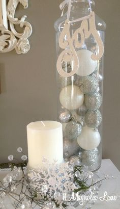White and silver ornaments in apothecary jars