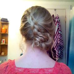 Great hair style for school or for a party(: A French braided into a bun.