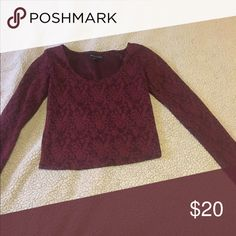 American eagle long sleeve crop top Maroon crop top with floral design. Super cute and In great condition! American Eagle Outfitters Tops Crop Tops