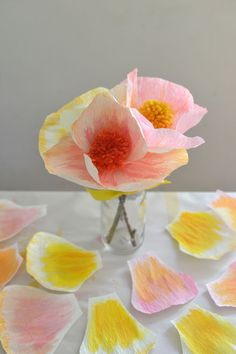 Make these beautiful and simple handmade flowers with crepe paper, watercolor paints, and pom-poms.
