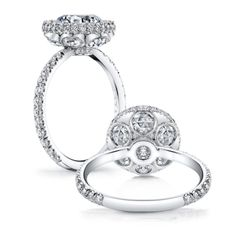 MARIE ANTOINETTE is a handcrafted Jean Dousset Diamonds engagement ring with one row of diamonds on the band - JeanDousset.com - pictured in Platinum with a Round cut diamond inside a seamless halo and 6 rose cut diamonds underneath.