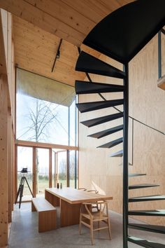 Architecture studio GAFPA used low-cost materials to build this Japanese-inspired weekend retreat in northern Belgium, which features a slender spiral staircase Cabin Interiors, Wood Interiors, Japanese Architecture, Architecture Details, Pin Maritime, Weekend House, Wood Cladding, Narrow House, Lots Of Windows