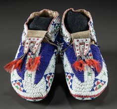 A PAIR OF SIOUX BEADED HIDE CEREMONIAL MOCCASINS. c. 1890... | Lot #50257 | Heritage Auctions