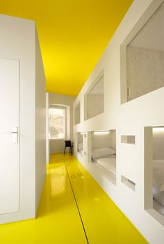 love the built ins and yellow contrasting floor and ceiling.