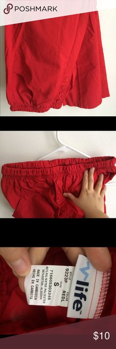 Red scrub pant. Red scrub pant with adjustable waistline. Stretchy waistband. Hip pockets. Buttons for design. Petite. life uniform Pants