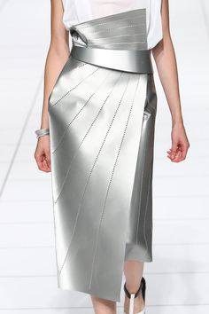 Silver leather skirt with sharp angles / crisp folds & perforated line patterns / architectural details