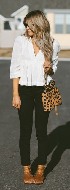 Monochrome + Cara Loren + black and white outfit + floaty v neck blouse + skinny black jeans + gladiator sandals + spring style  Top: Free People, Jeans: J Brand, Sandals: Steve Madden.