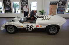 Jim Hall's son in the car. Jim Edwards, who works directly for Jim Hall, and Keith Doucet, Chaparral car specialist. Bill Salati photo.