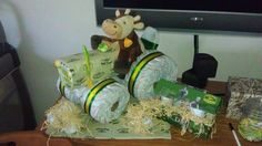 John Deere Tractor Diaper Cake....made by yours truly! Check out my FB page if you're interested in having one for your own baby shower or a friend's!