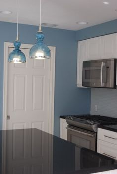 love these blue pendant lights and bright blue kitchen makeover #blue #pendantlight #kitchen