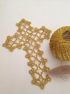 Really pretty cross pattern - nice golden yellow thread.