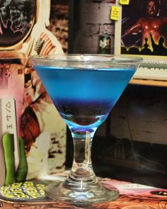 MST3K Cocktails: Hercules Unchained  3 parts gin 1 part vermouth 1/4 part blue curacao 1/2 part grenadine Shake together gin, vermouth, and blue curacao with ice; strain into glass; drizzle grenadine over glass
