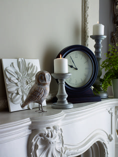 Cute home accessories can change a room and candles bring warmth. #home #candles #owl