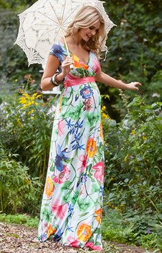 A new bold floral print Hawaiian Breeze maxi maternity dress gets you noticed anywhere from a fashionable summer garden party to a day at the races.
